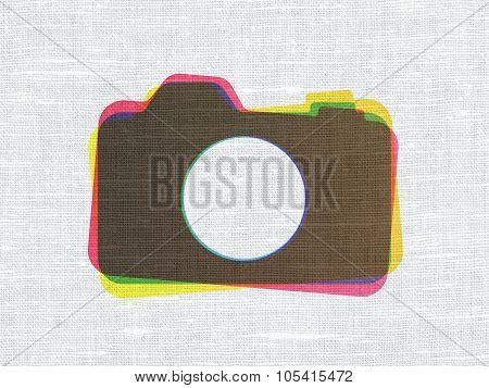 Tourism concept: Photo Camera on fabric texture background