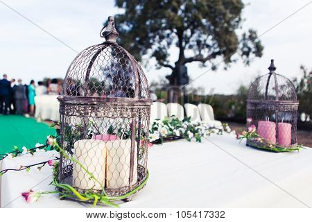 Vintage Wedding Altar With Birdcage, Candles And Plants. Close Up Detail.