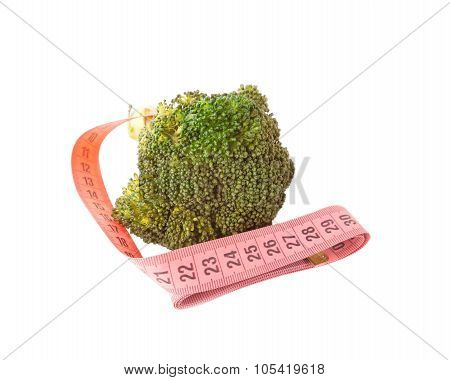 Broccoli with meter isolated on white.