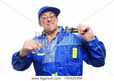 adult drunk mechanic working with glass of alcohol.