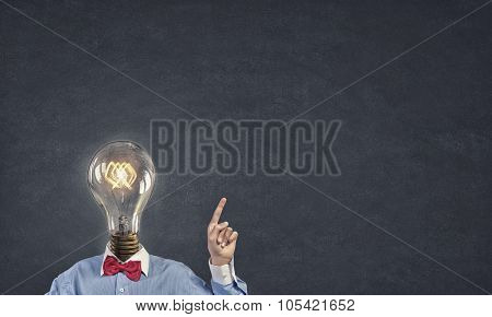 Unrecognizable man in bow tie with light bulb instead of head
