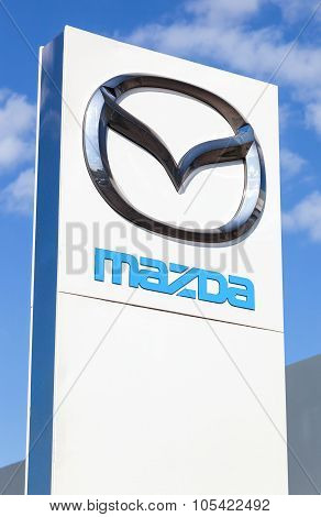 Official Dealership Sign Of Mazda. Mazda Motor Corporation Is A Japanese Automaker