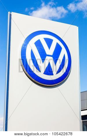 Official Dealership Sign Of Volkswagen Against Blue Sky