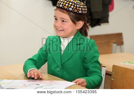 Ashgabad, Turkmenistan - November 4, 2014. Portrait Of An Unknown Schoolgirl In The Classroom.