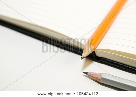 Notepads And Pencils On A White Background