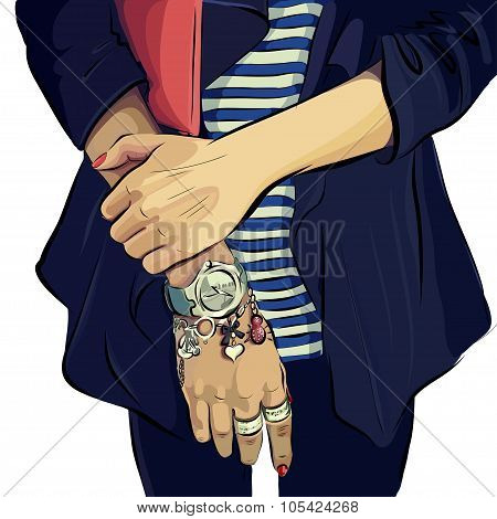 Woman's hands with clutch bag and bracelet.