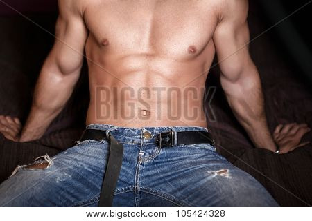 Sexy Man Body With Six Pack Sitting On Bed