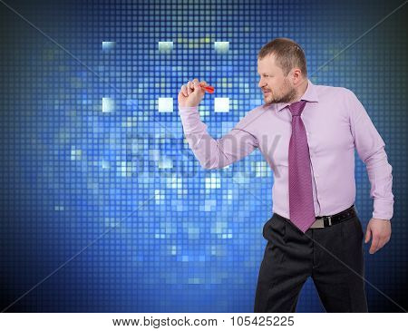 Businessman aiming dart at the target