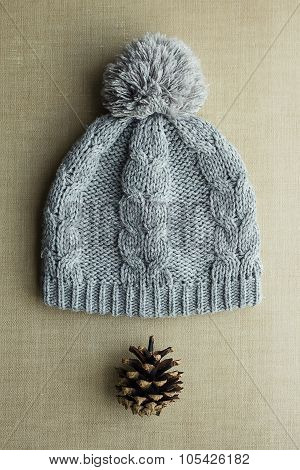 Knitted Gray Hat With Pompom And Pine Cones