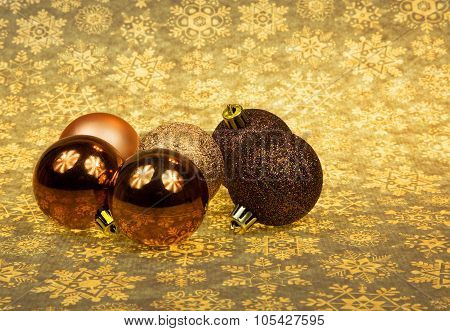 Five Christmas Baubles On A Christmas Background.horizontal.