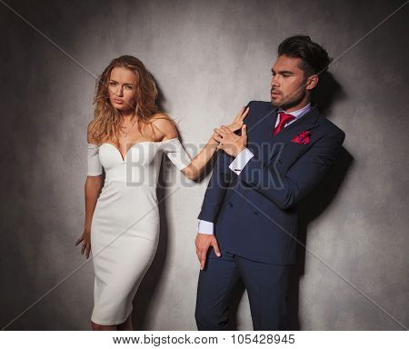 elegant fashion man is pushed away by his lover , they fight in studio