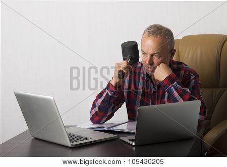 Angry Man Crashing Laptop