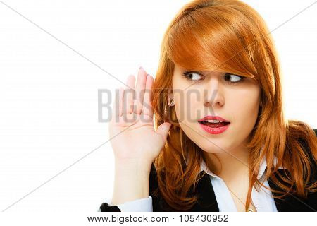 Woman With Hand To Ear Listening