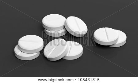 White round pills, isolated on black background.