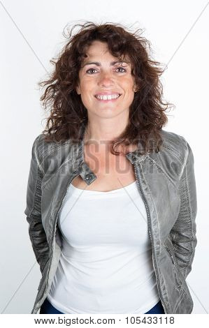 Woman, Middle Aged, With A Green Leather Jacket Smiling