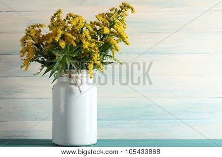 Beautiful mimosa flowers on wooden background