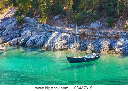 Blue Boat On Turquoise Seawater