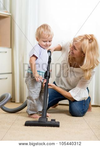 family have fun with cleaning with hoover - housework