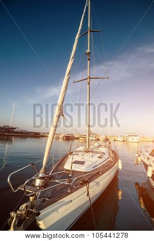 yacht in a berth on blue sea and blue sky background