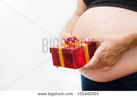 Pregnant woman with a gift box