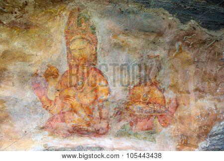 SIGIRIYA, SRI LANKA - MARCH 20, 2015: Sigiriya maiden - 5th century frescoes at the ancient rock fortress of Sigiriya in Sri Lanka