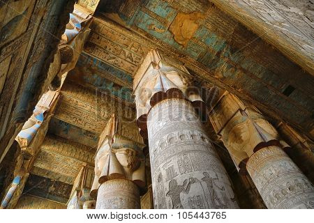 DENDERA, EGYPT - DECEMBER 05, 2014: Interior of the painted and carved hypostyle hall at Dendera Temple. Ancient Egyptian temple near Qena.