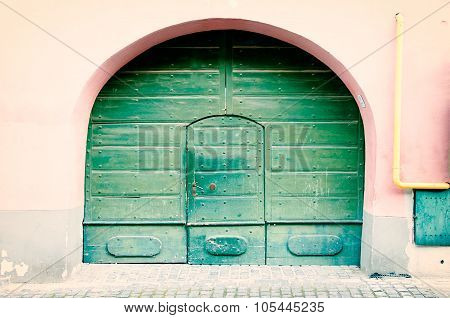 Vintage door through an arch