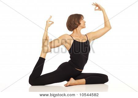Young woman doing yoga Pigeon Pose