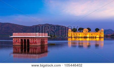Panorama of Rajasthan landmark - Jal Mahal (Water Palace) on Man Sagar Lake in the evening in twilight.  Jaipur, Rajasthan, India