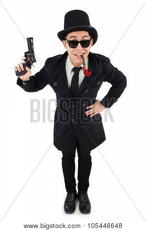 Young detective in black coat holding handgun isolated on white