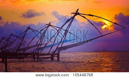 Panorama of Kochi tourist attraction - chinese fishnets on sunset with grunge texture overlaid. Fort Kochin, Kochi, Kerala, India