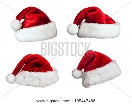 Several Santa Claus fur hats isolated on white background
