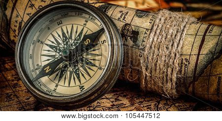 Travel geography navigation concept background - letterbox panorama of  old vintage retro compass on ancient world map