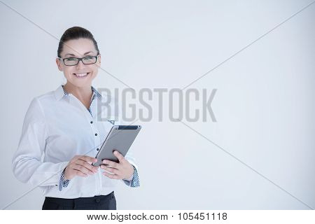 Businesswoman with laptop isolated on a white