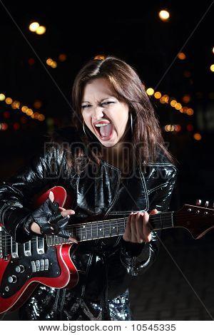 Brunettte Guitar Player Girl In The Night