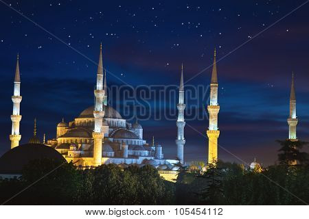 Blue Sultanahmet Mosque at night time with fantastic sky and stars, Istanbul, Turkey
