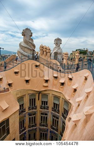 BARCELONA, SPAIN - MAY 02: Overview from Rooftop of Casa Mila Sculptures and Courtyard, Designed by Antoni Gaudi and Popular Tourist Destination in Barcelona, Spain. May 02, 2015