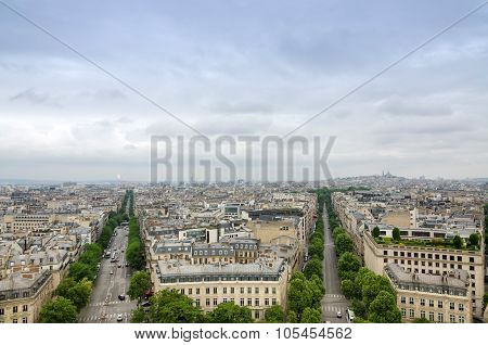 View Of The Champs Elysees With Montmartre In The Background