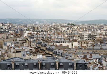 Roofs Of Paris With Moody Sky