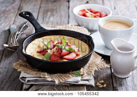 Baked pancake in cast iron pan