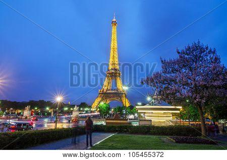 Paris, France - May 14, 2015: Eiffel Tower Brightly Illuminated At Twilight