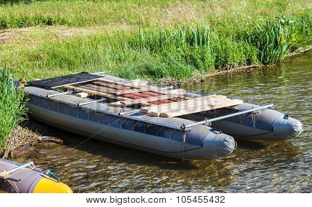 Sports Catamaran On The Shore Of Lake In Summer Day