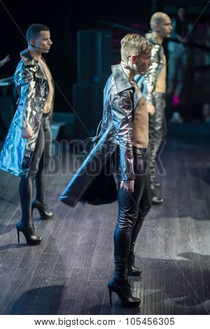 RUSSIA, MOSCOW -?? NOV 30, 2014: Three dancers of Kazaky band in leather coat and trousers are standing on the stage.