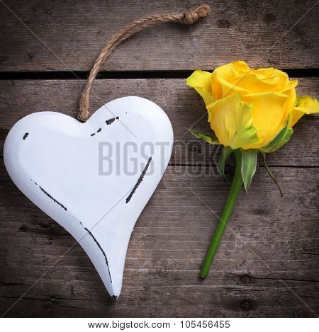 Background With  Beautiful Yellow Rose And Decorative Heart