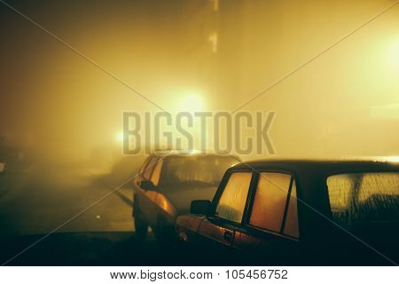 Car in the fog.