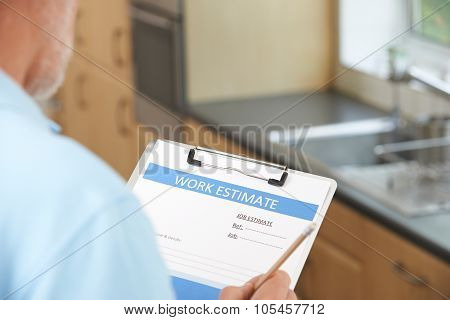 Builder Preparing Estimate For Home Improvement