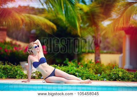 Beautiful Young Woman Relaxing On Vacation Near The Pool