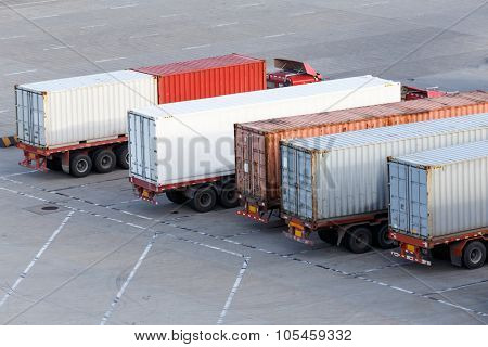 Transportation of cargoes in containers by lorry