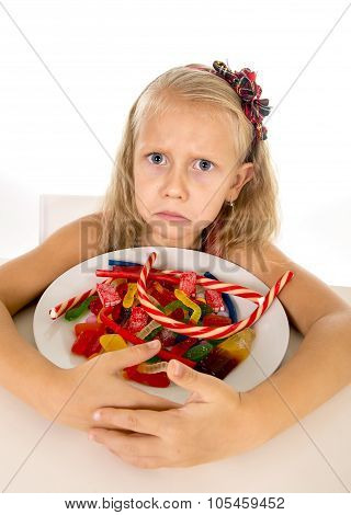Pretty Sad Caucasian Female Child Eating Dish Full Of Candy In Sweet Sugar Abuse Dangerous Diet
