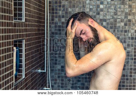Young Man Washing His Hair In The Shower
